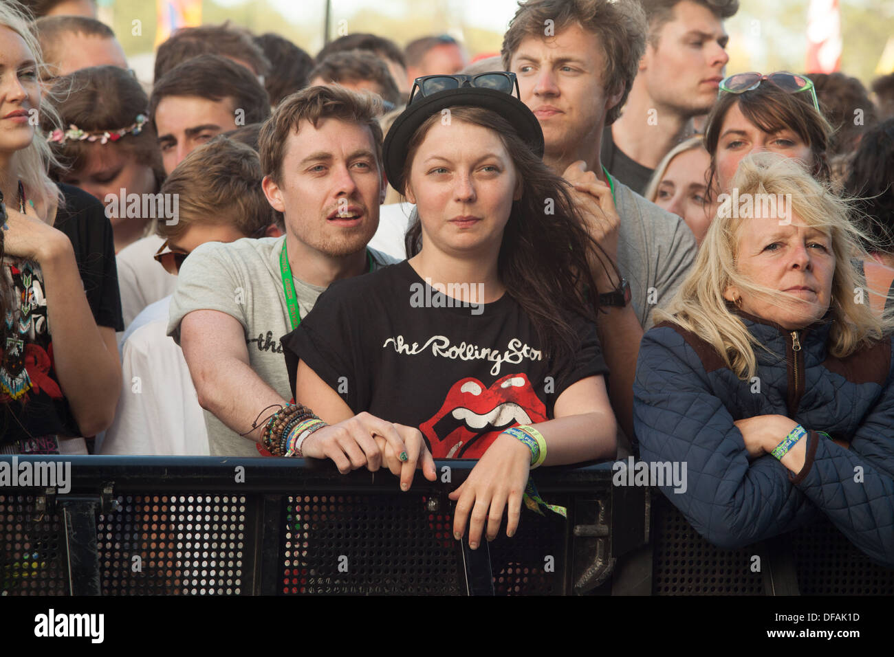 Fans waiting to watch the Rolling Stones headline Glastonbury Festival, Worthy Farm, Somerset, England, United Kingdom. - Stock Image