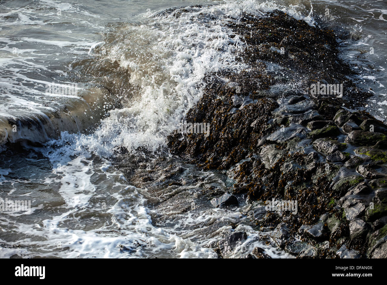 Waves Breaking Against Sea Defences Stock Photo