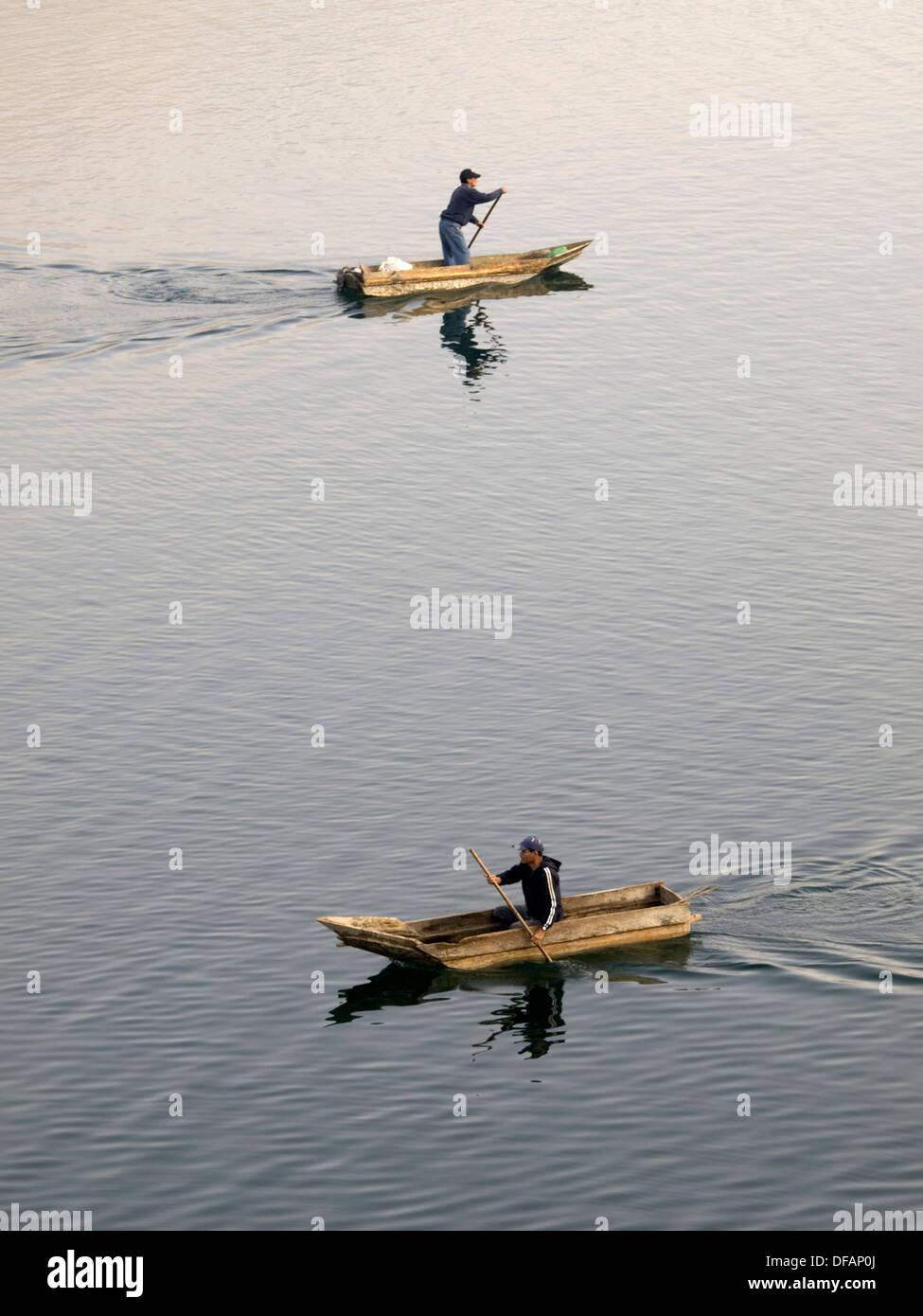 Fishermen at work on Lake Atitlan in Santiago Atitlan, Solola, Guatemala Stock Photo