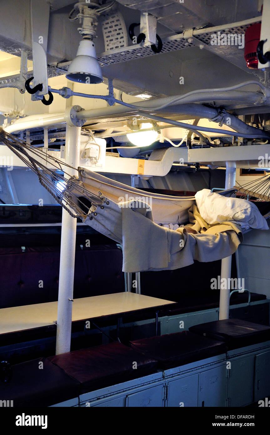 Chatham, Kent, England, UK. Chatham Historic Dockyard. HMS Cavalier. Forward seaman's mess - hammock - Stock Image