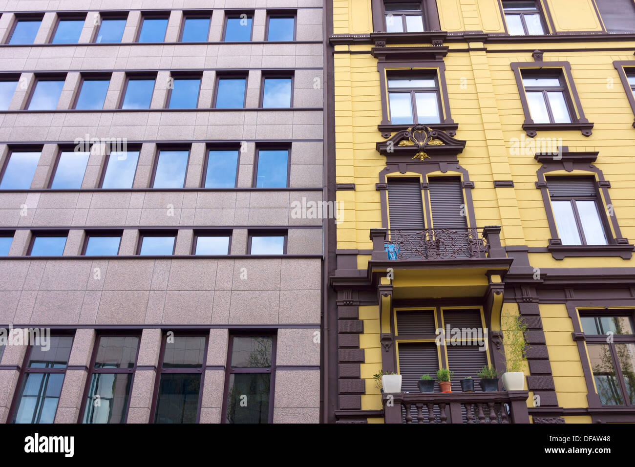 Facade Of A Modern Apartment Building Beside An Old Apartment Building In  Frankfurt, Germany