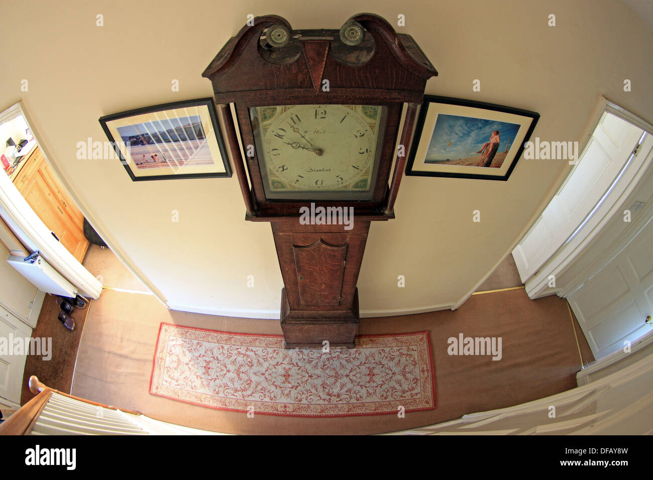 Grandfather clock in house hallway - Stock Image