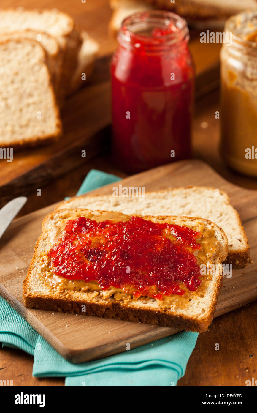 Homemade Peanut Butter and Jelly Sandwich on Whole Wheat - Stock Image