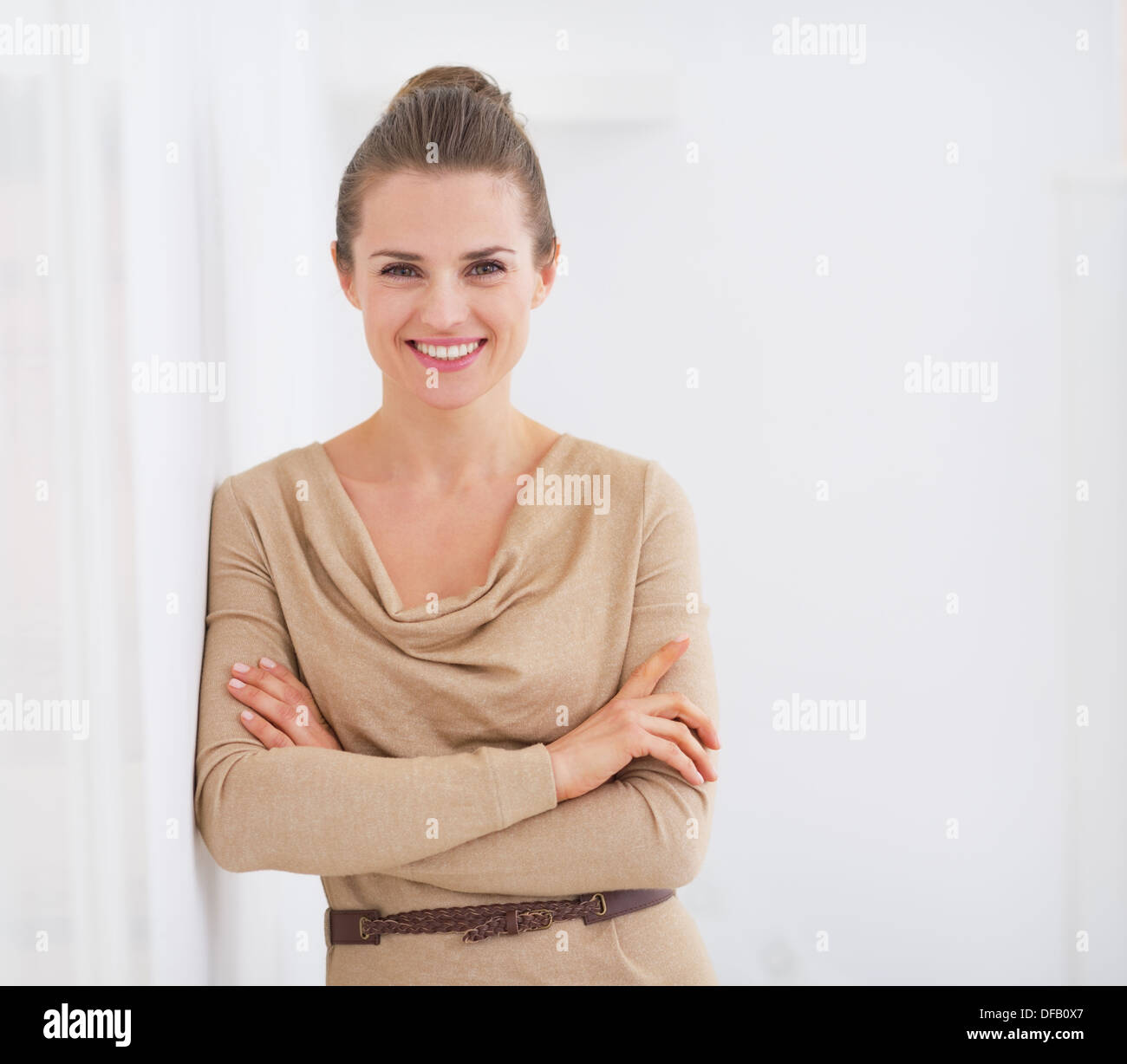 Portrait of happy young housewife - Stock Image