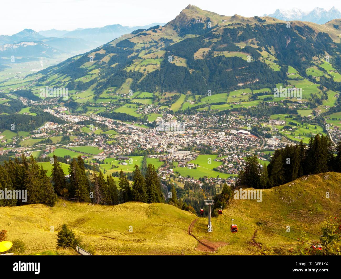 Summer looking down hahnenkamm ski run towards Austria kitzbuhel town at the bottom  Europe horn in background - Stock Image