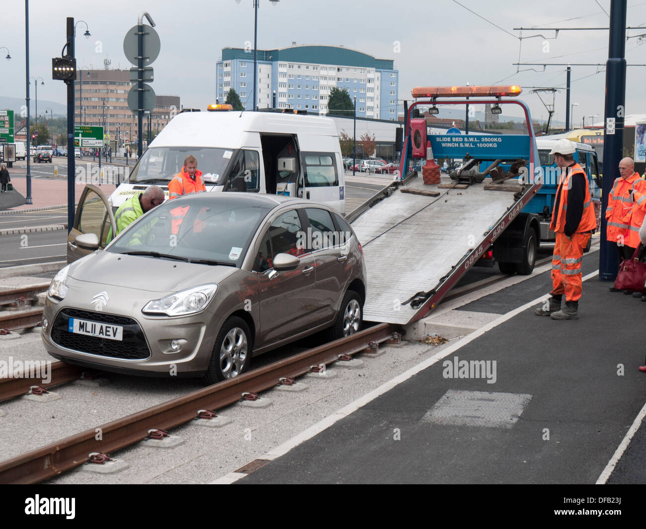 Ashton-under-Lyne, Greater Manchester, UK. 01st Oct, 2013. A car was driven onto the new Metrolink tram tracks near the centre of Ashton-under-Lyne, which has not yet opened for passenger services. There were no injuries. The final phase of testing began yesterday (30 Sept) and full passenger services are due to begin next week on the 9th October. Credit:  Vincent Lowe/Alamy Live News - Stock Image