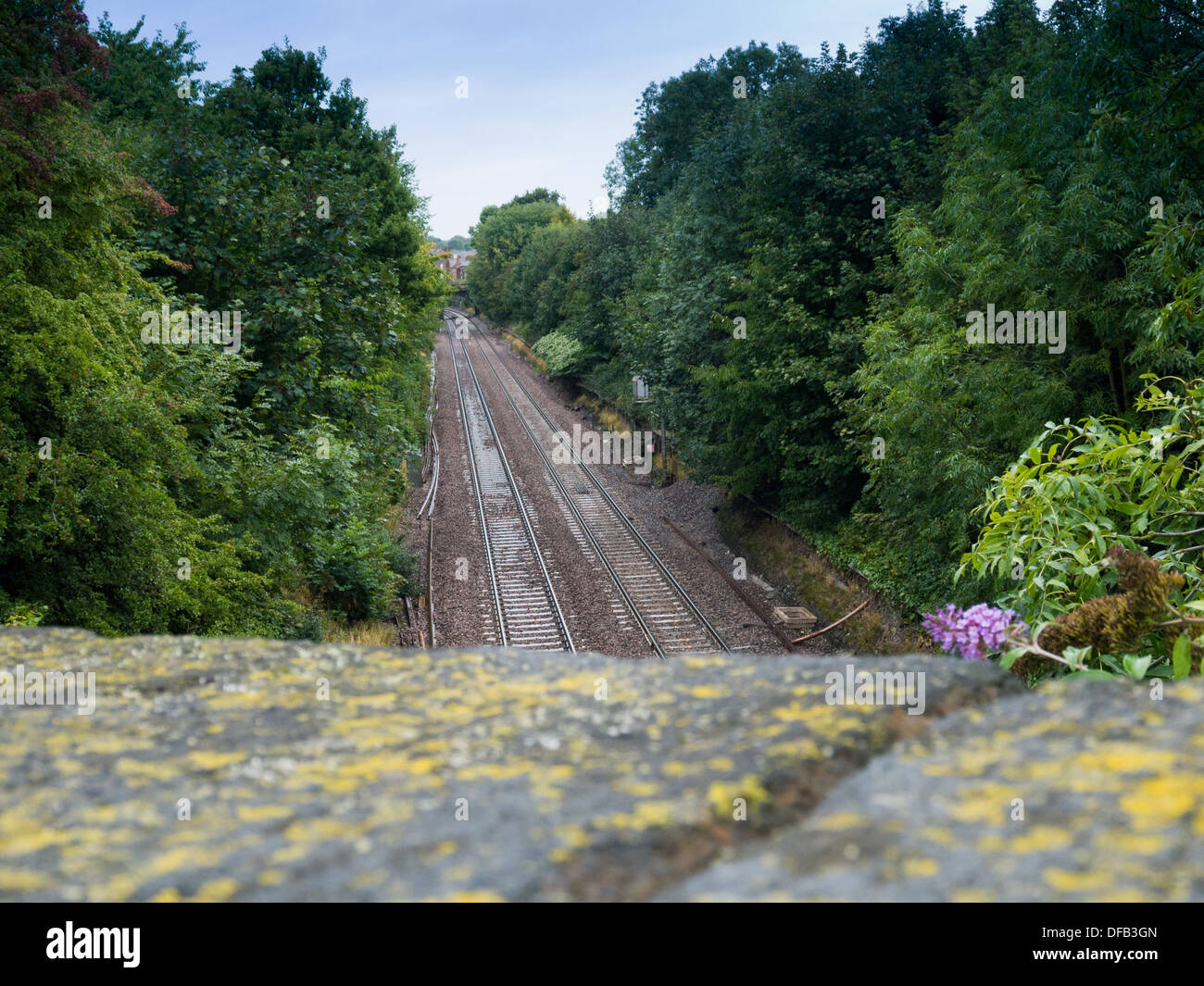 Overlooking a train line from a bridge. This was taken in Belper, Derbyshire, United Kingdom. - Stock Image