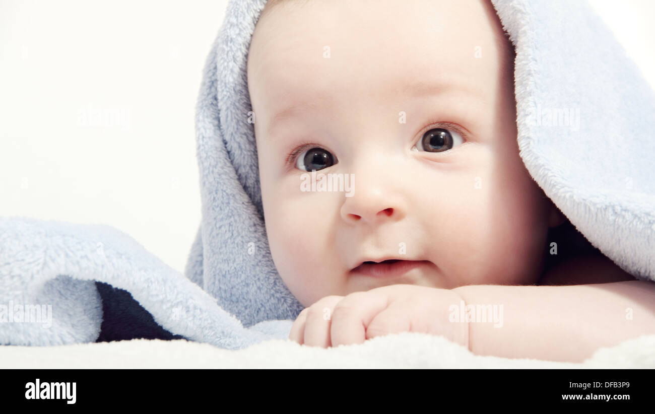 baby after bath under a blanket - Stock Image