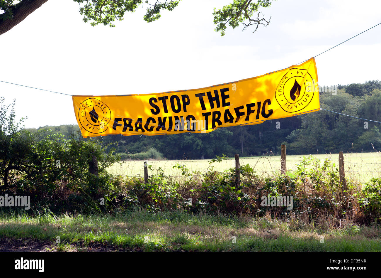 Stop the fracking traffic banner strung between two oak trees near to a proposed drilling site at Fernhurst. West Sussex - Stock Image