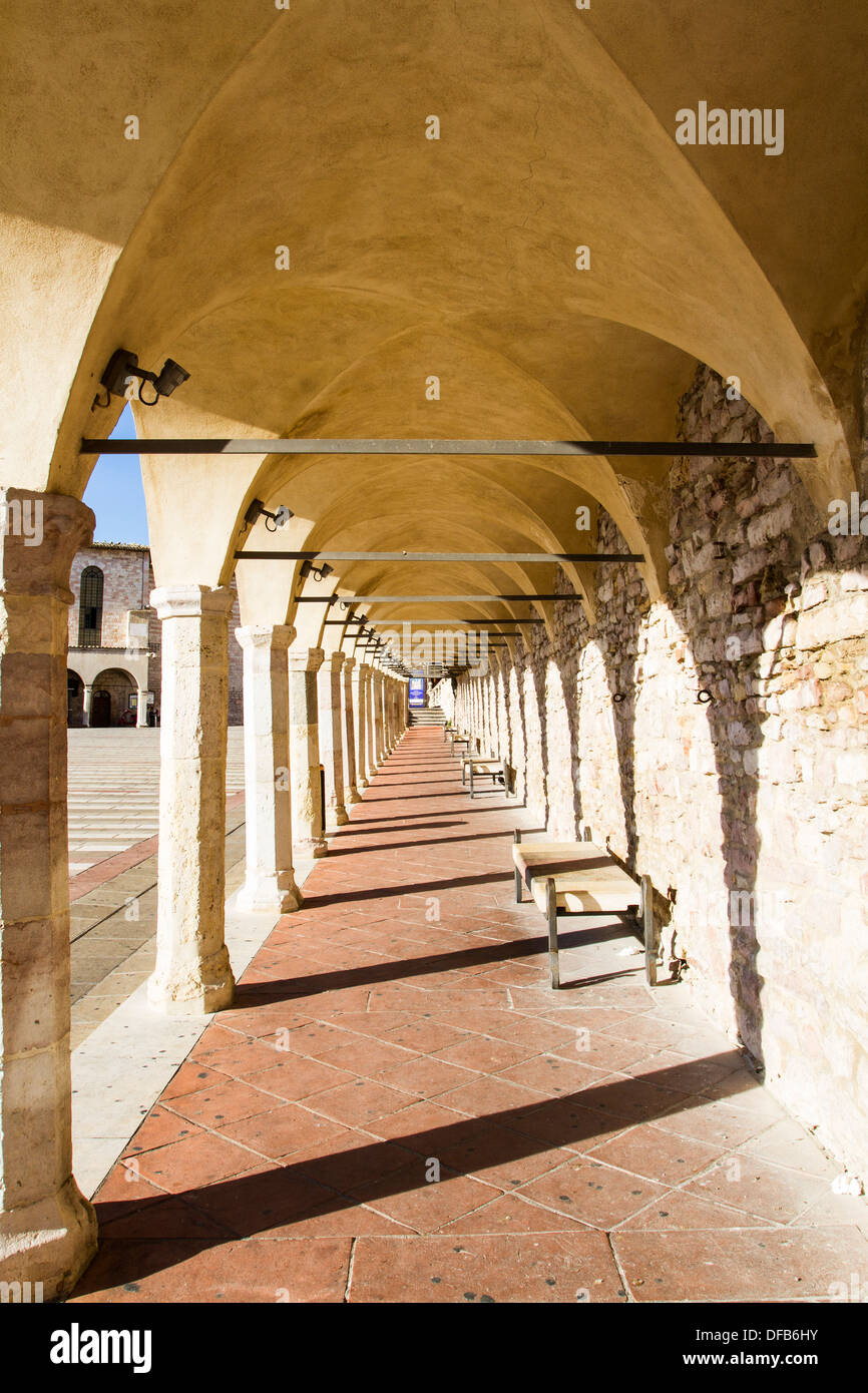 Arcade passage at Basilica of San Francesco d'Assisi. Assisi, Province of Perugia, Italy. - Stock Image