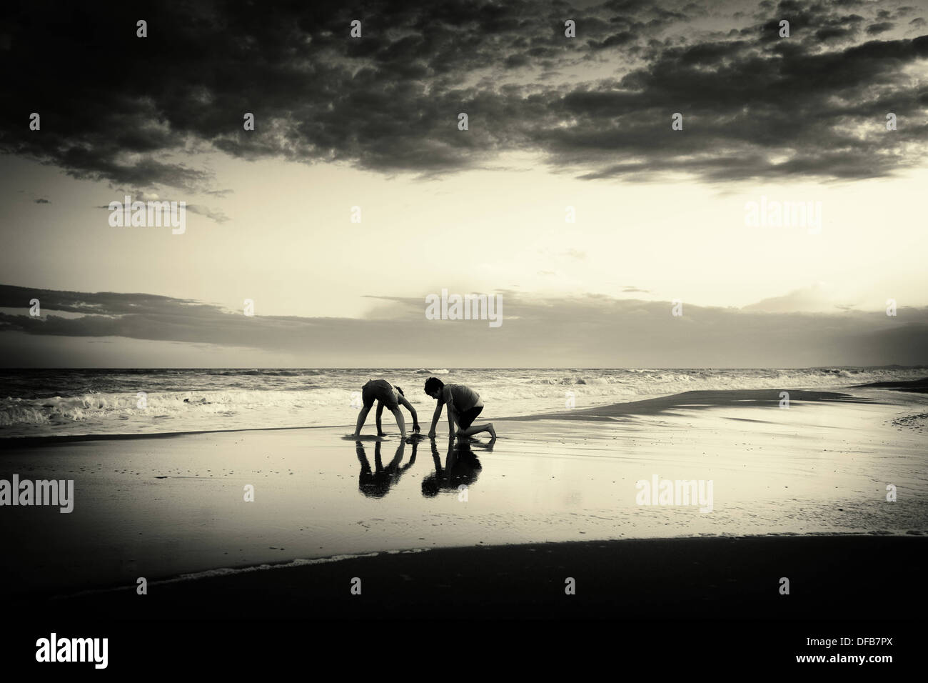 Children playing on the beach - Stock Image