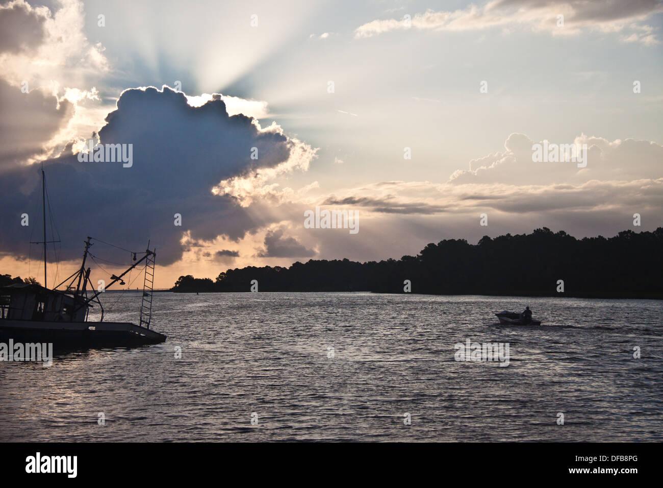 Fisherman heading out at sunrise - Stock Image