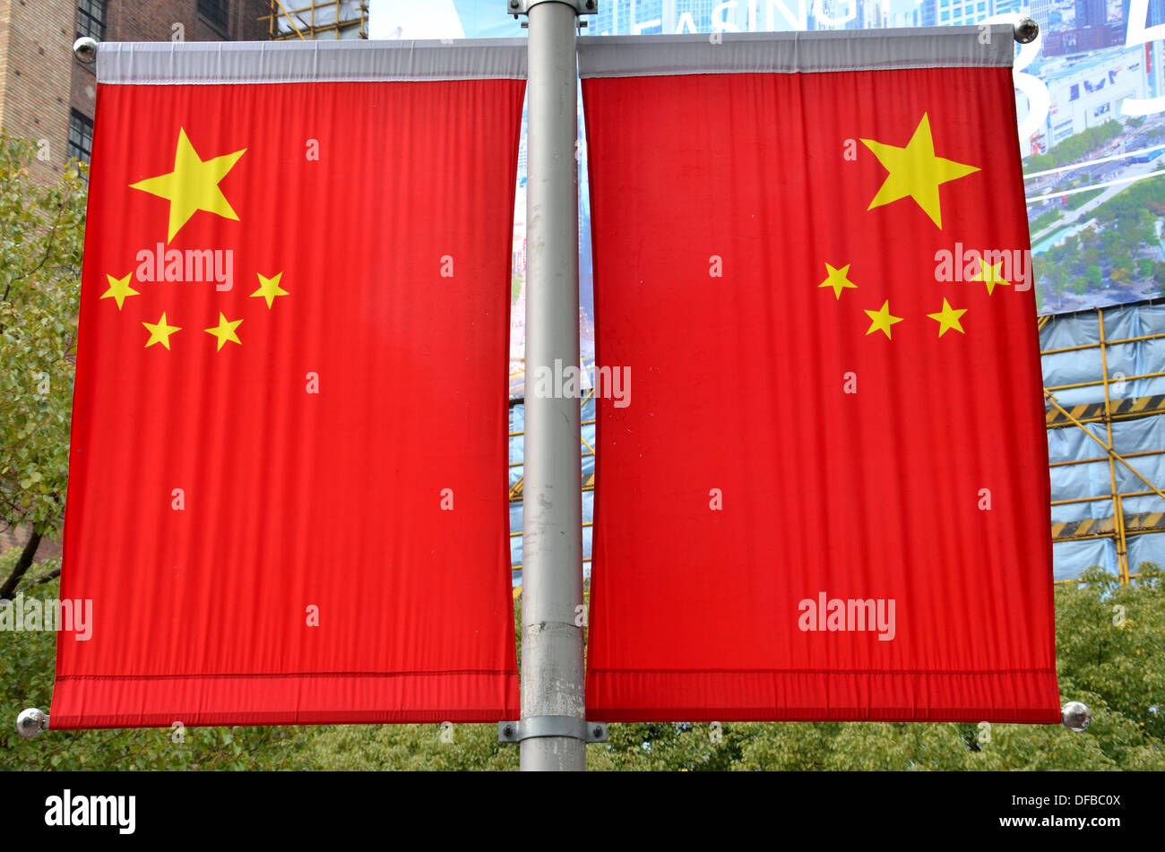 Two China flags on Shanghai lamppost - Stock Image