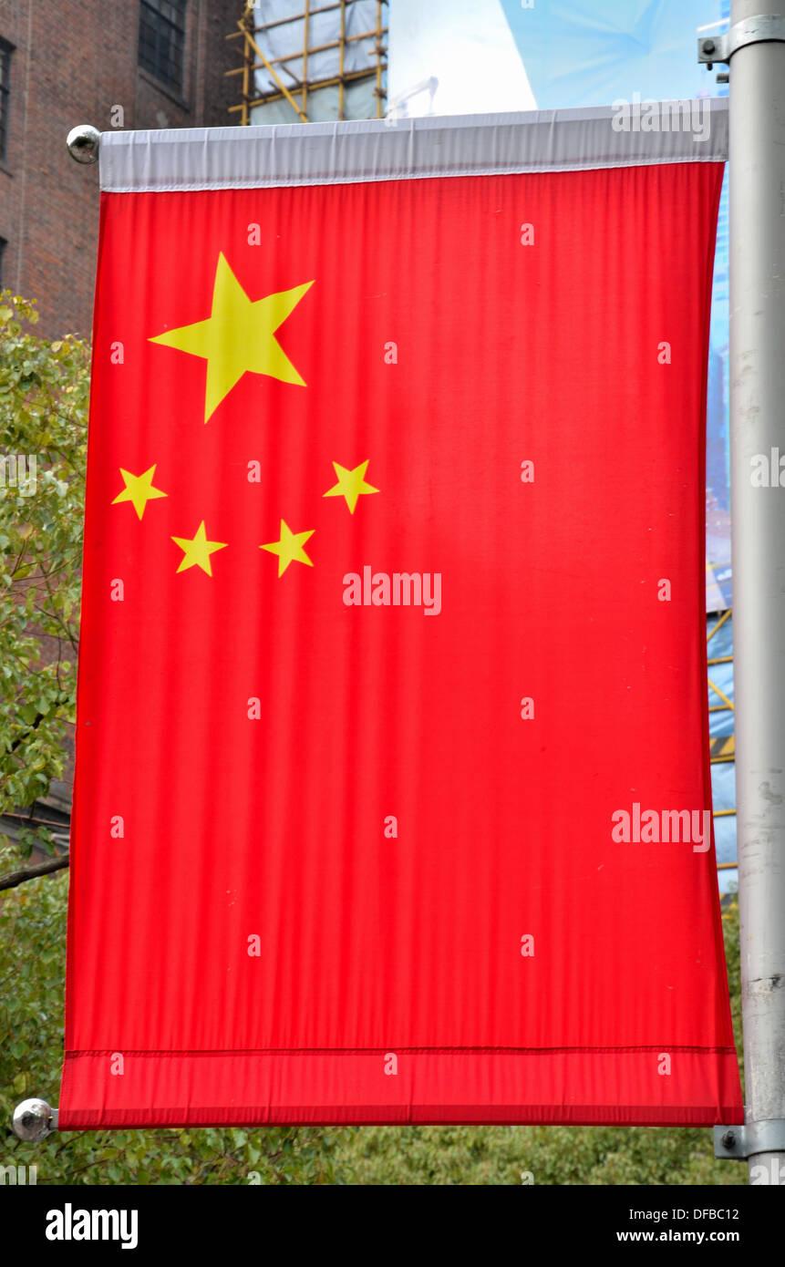 China flag hangs on pole Shanghai - Stock Image