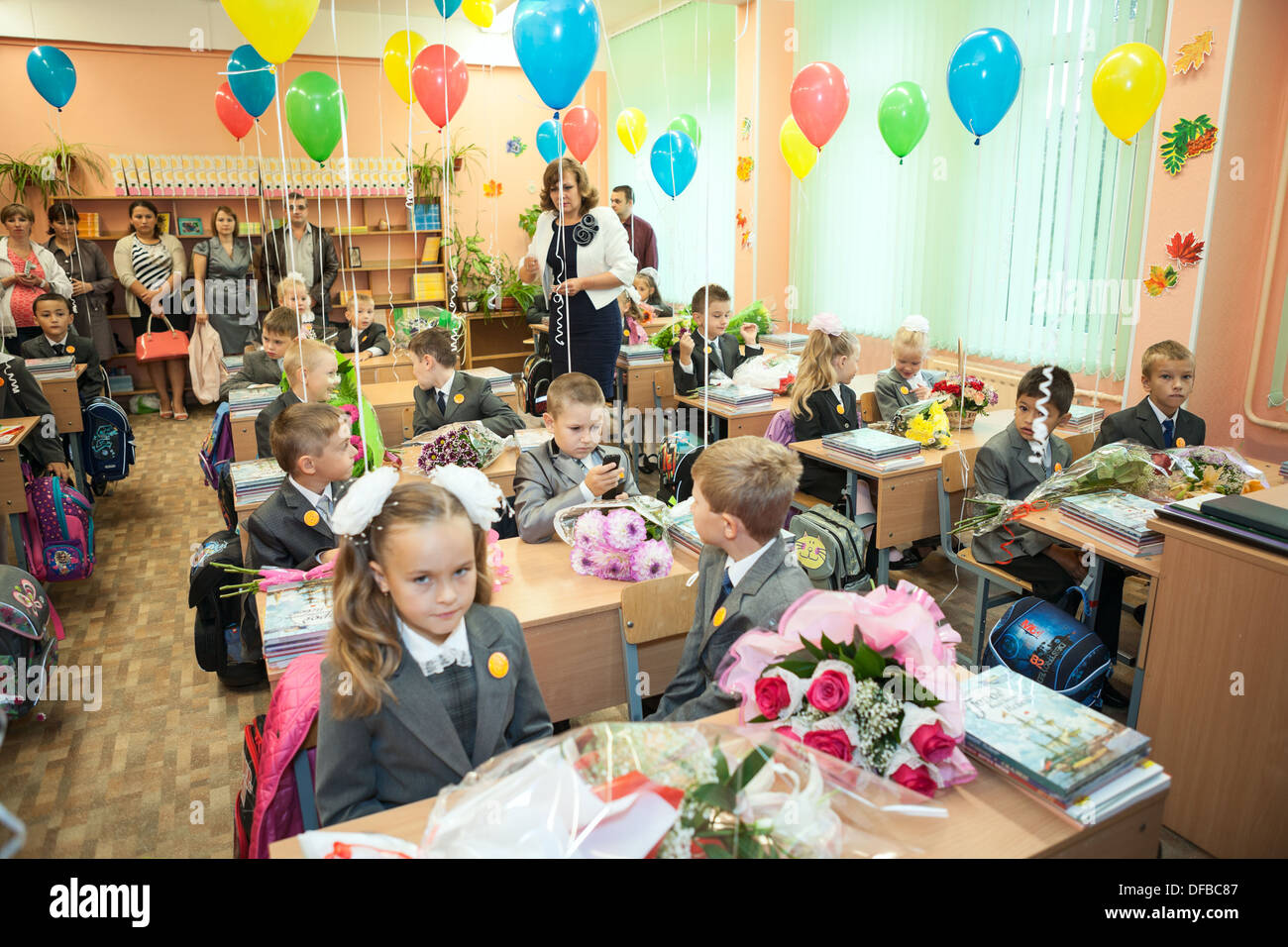 small students sitting in decorated classroom at the first lesson in
