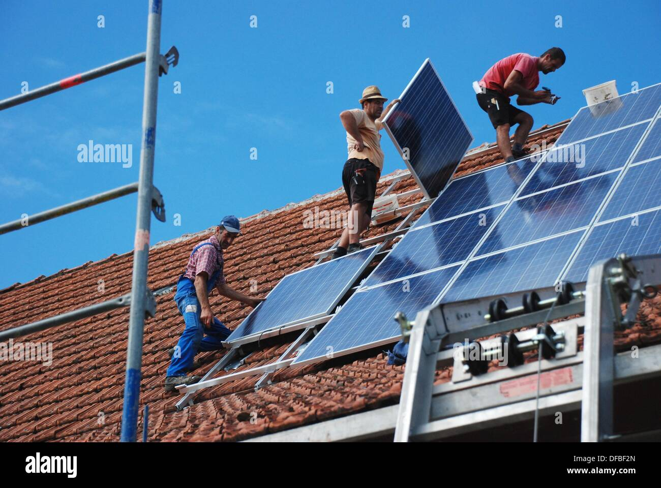 Installation of a solar energy system - Stock Image