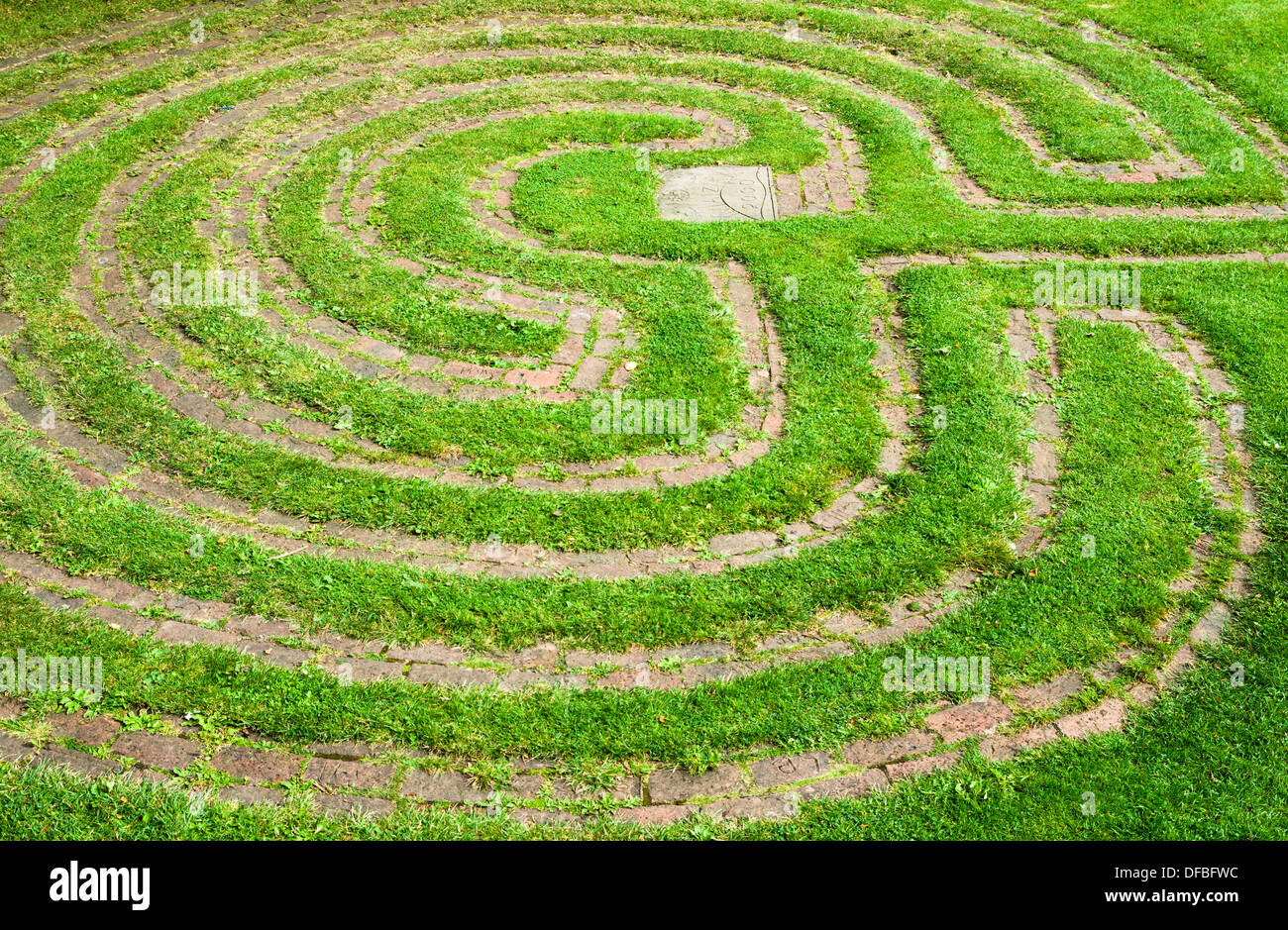 A labyrinth cut in grass - Stock Image