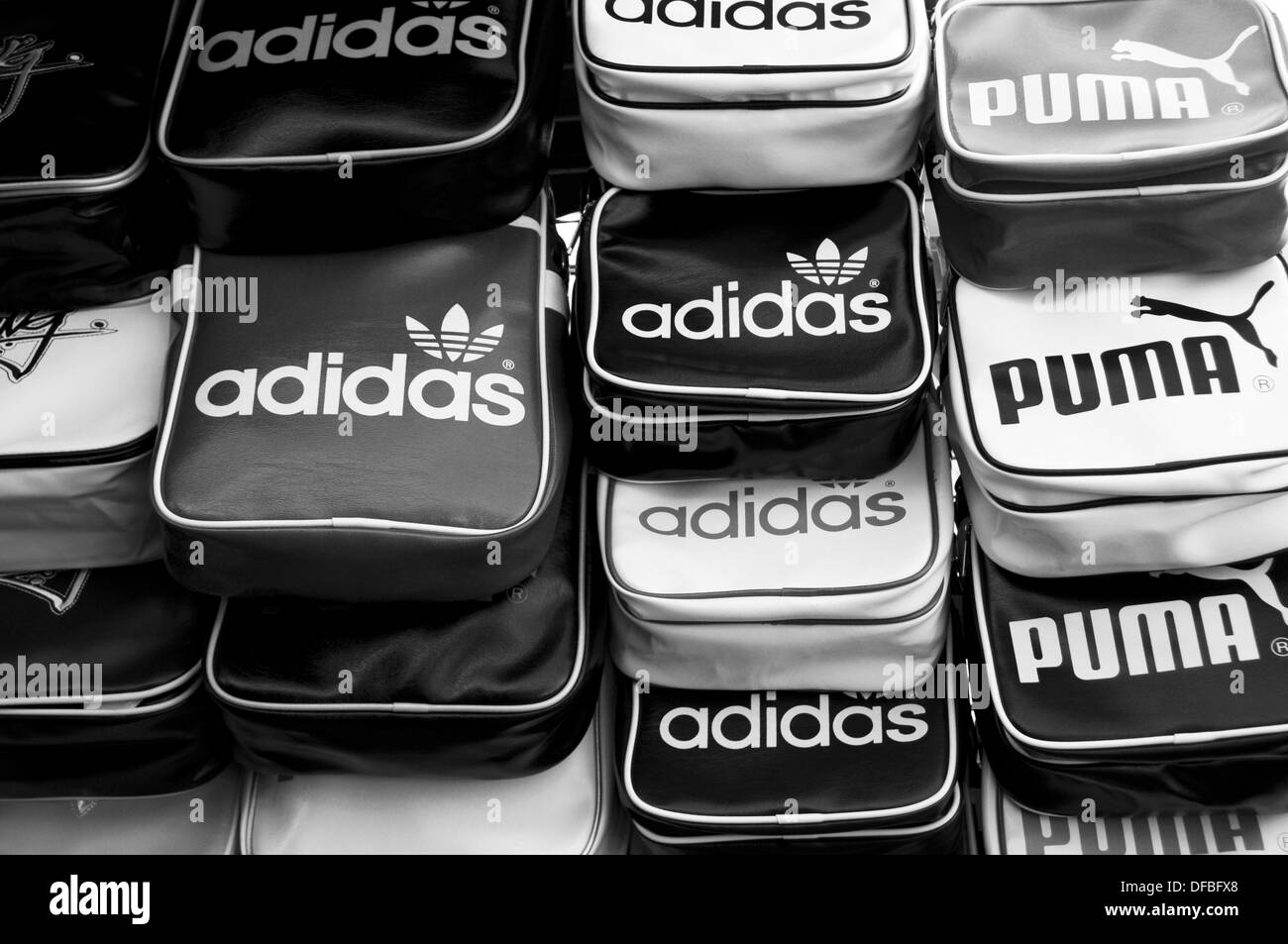 Fake Adidas and Puma sports bags at a market in Bangkok - Stock Image