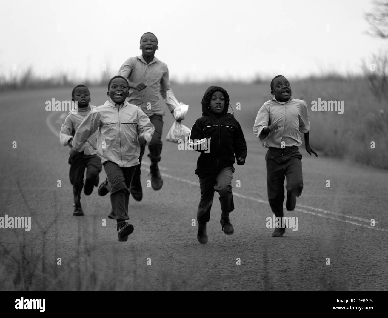 Children run to school to school in Umlaas Road, 18 October 2007. - Stock Image
