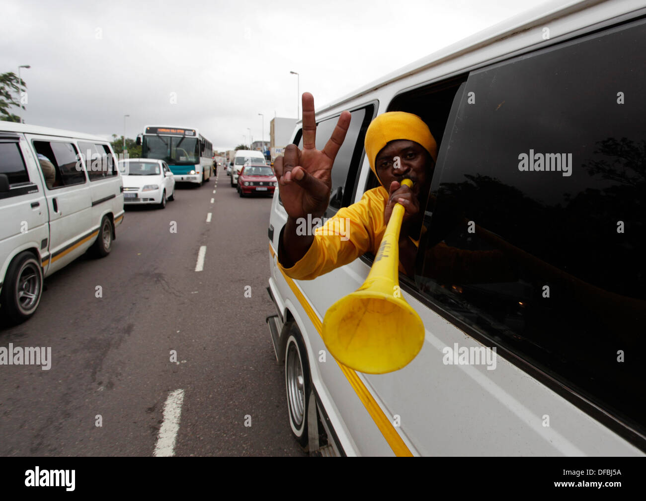 A Kaizer Chiefs supporter travels by taxi to Moses Mabhida Stadium in Durban where his team played Mamelodi Sundowns December - Stock Image