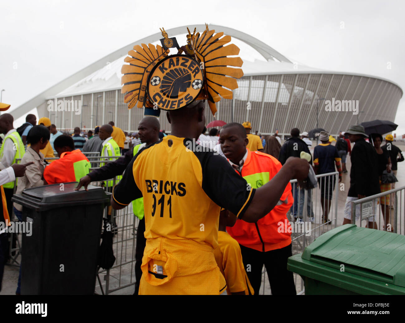 A soccer fan is checked by security etering Moses Mabhida Stadium in Durban where Kaizer Chiefs played Mamelodi Sundowns - Stock Image