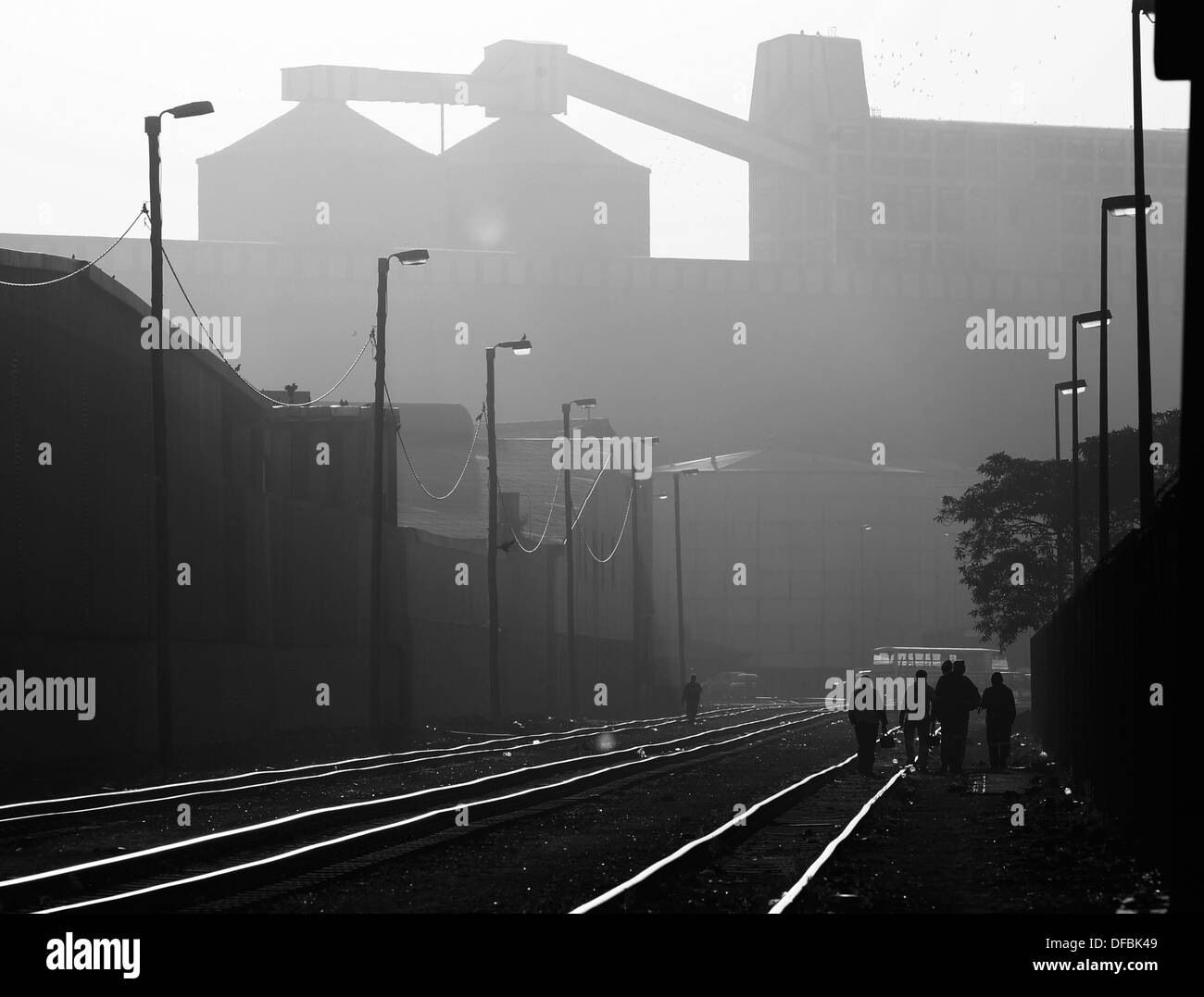 Workers walk on the railway tracks at the Durban harbour, July 15, 2010. © Rogan Ward 2010 - Stock Image