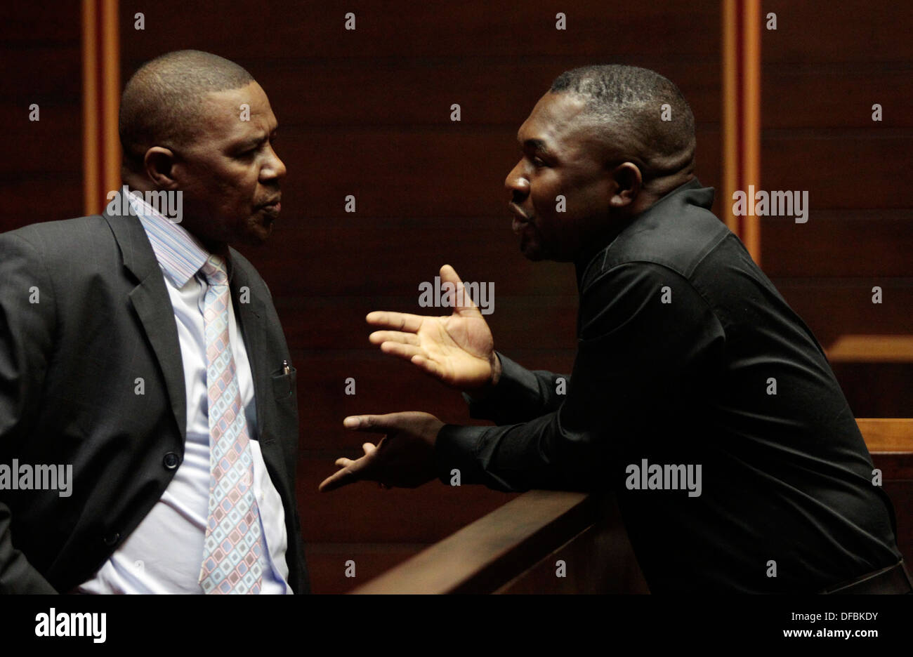 Frank Nabolisa speaks with his counsel from dock Pietermaritzburg High Court 12 October 2010 Cwele wife Minister State Security - Stock Image
