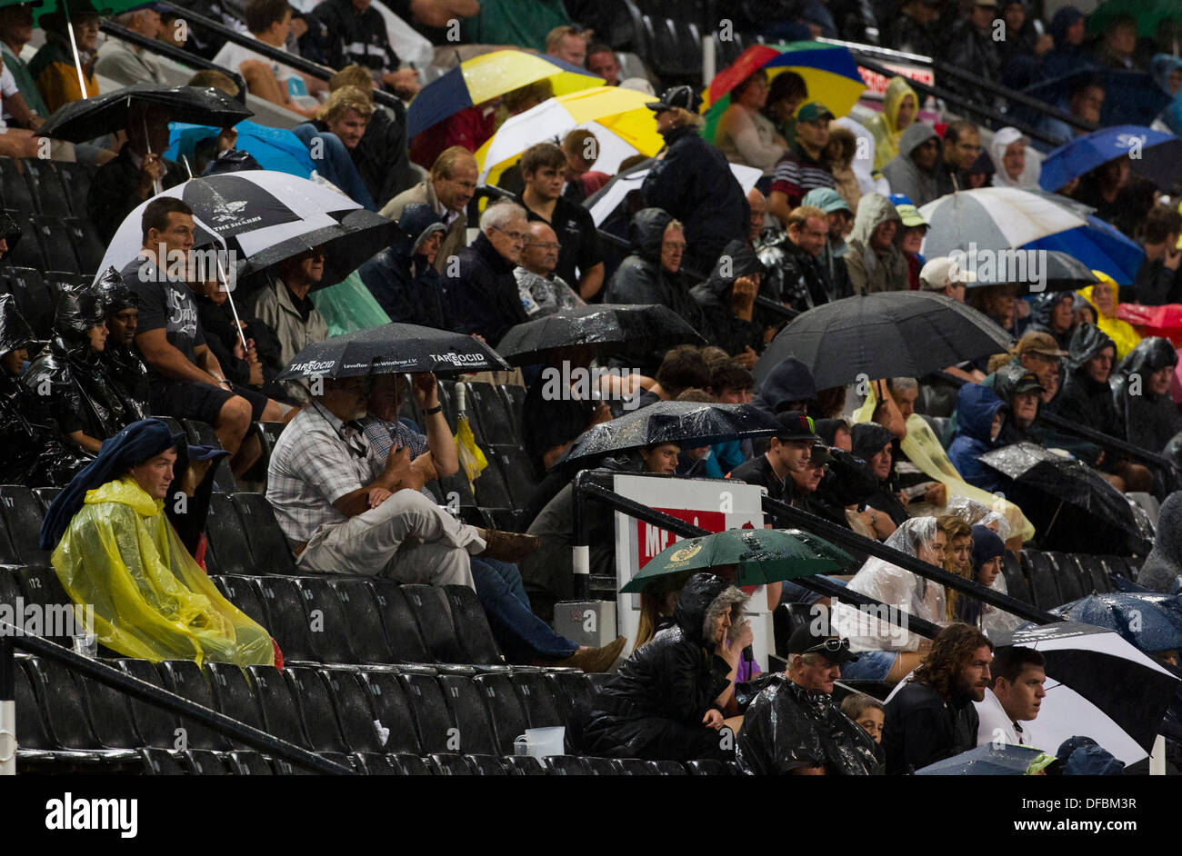 Spectators watch Sharks play against Reds during a Super 15 rugby match Kings Park Stadium in Durban 17 March 2012 © Rogan Ward - Stock Image