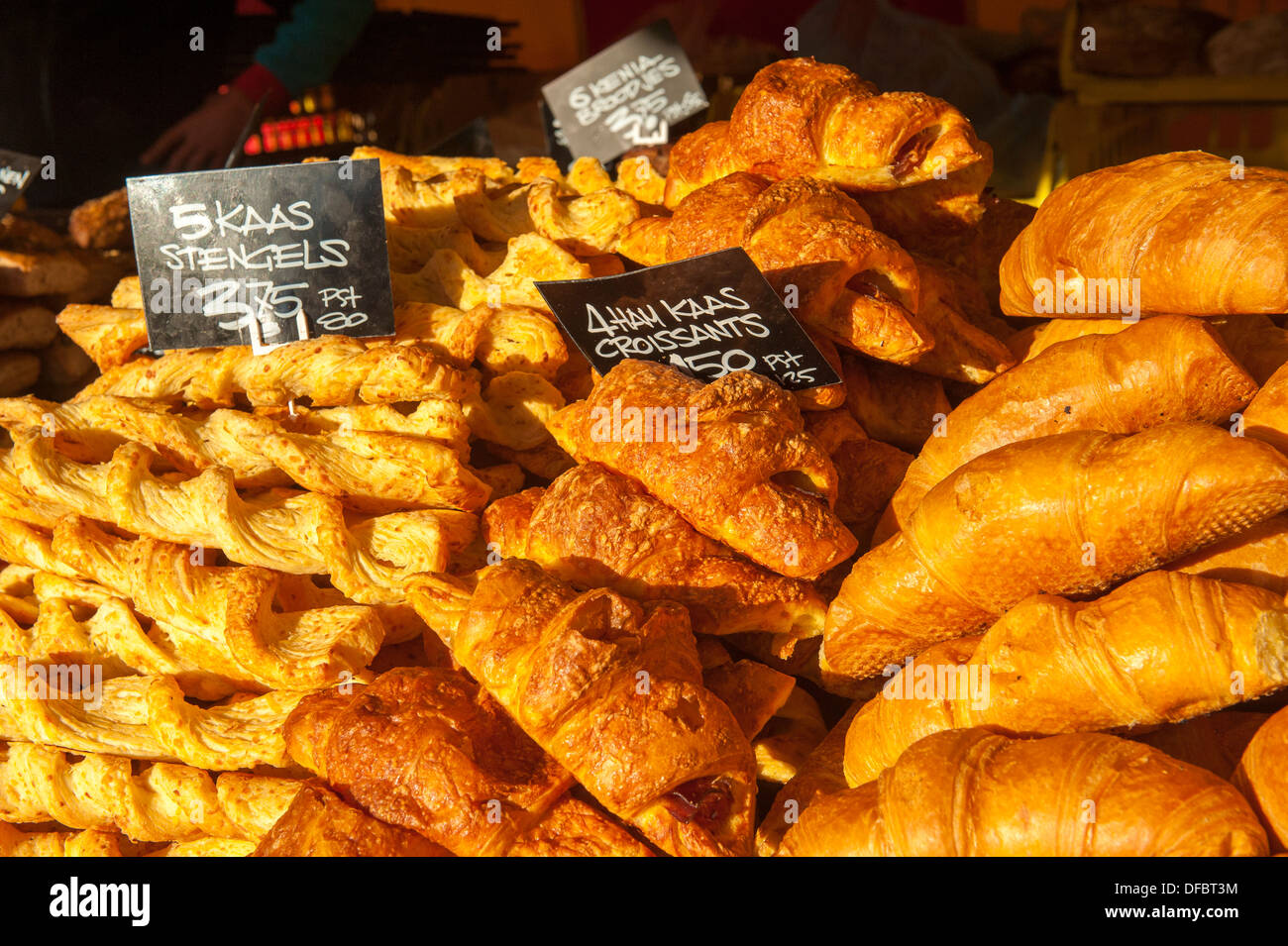 Croissants and Dutch Kaas Stengels sold on the market in Amersfoort, Netherlands - Stock Image