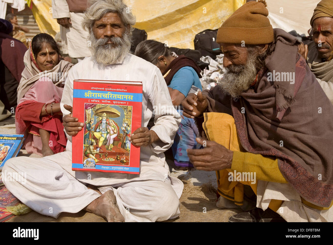 A man showing me a re - written version of the Ramayana. He had a small shop on the pavement of a street of the Ardh Khumbh - Stock Image