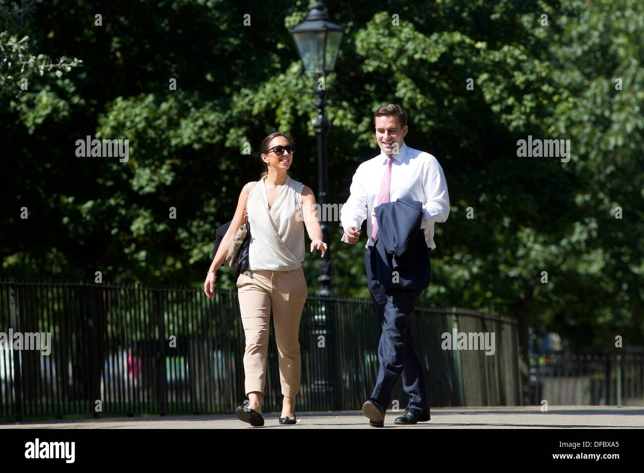 United Kingdom, London : Business people take a walk through Hyde Park to enjoy the hot weather in London on August 29, 2013. - Stock Image