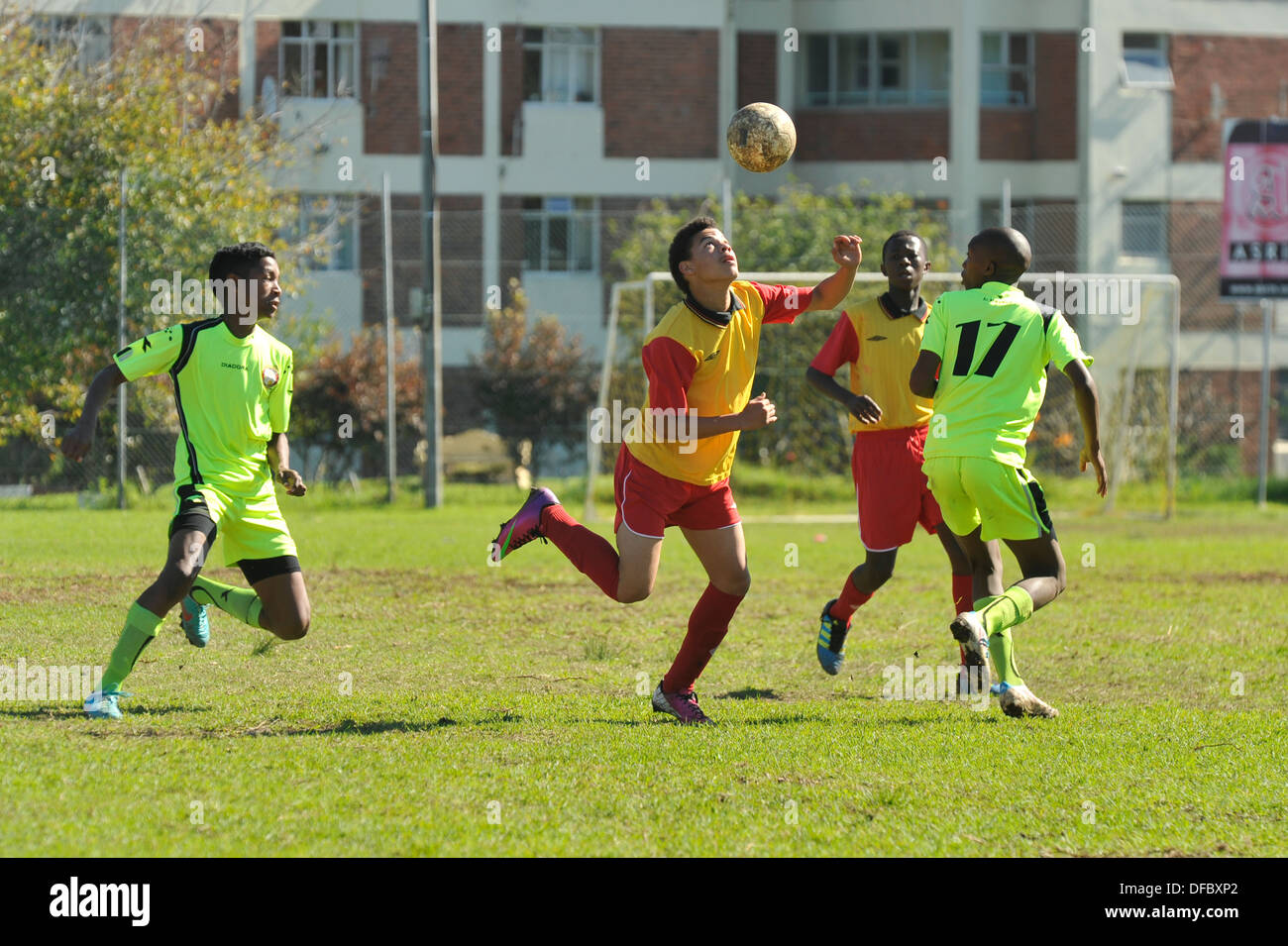 Junior football player heading the ball, Cape Town, Western Cape, South Africa - Stock Image