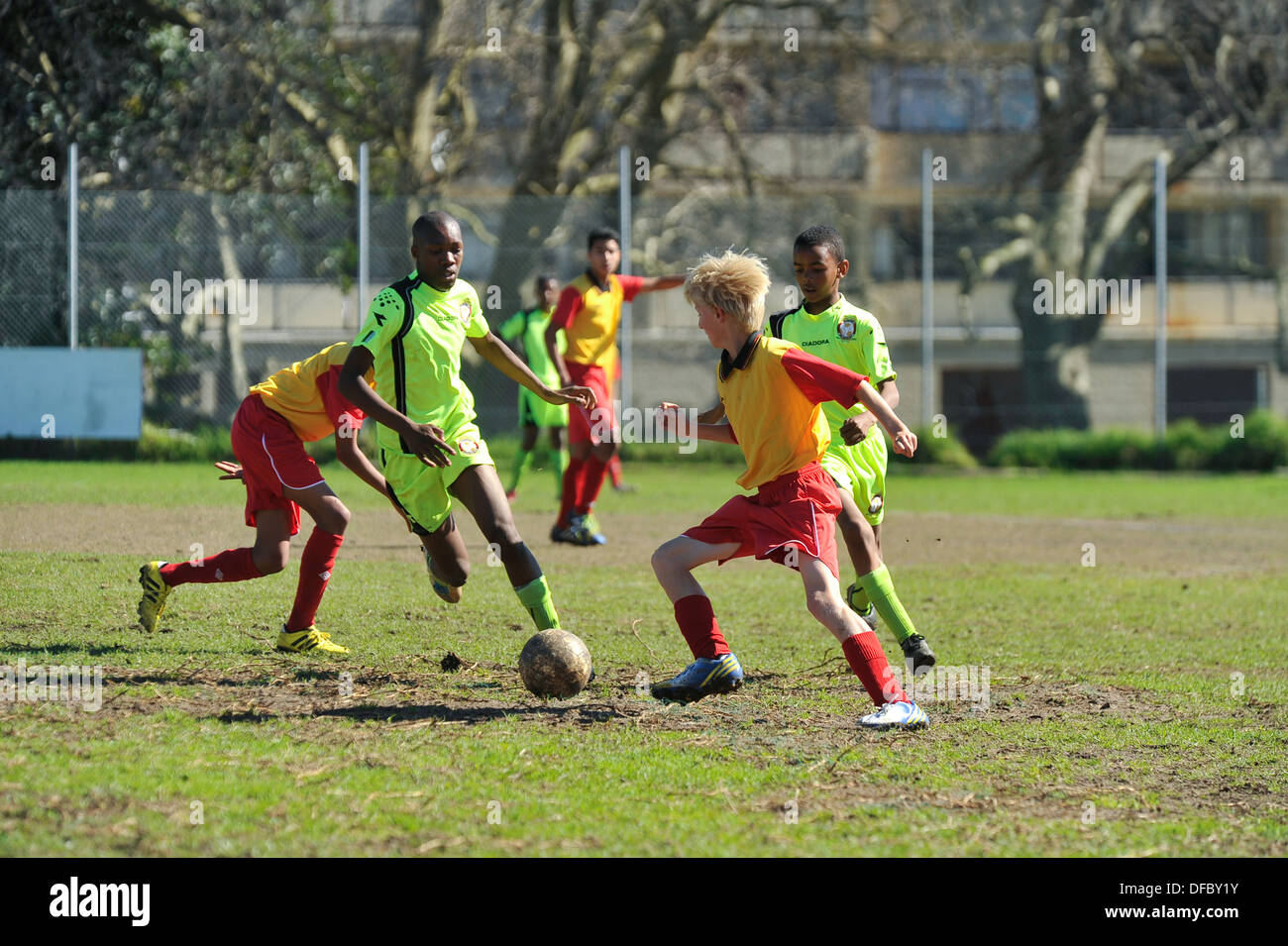 Junior football players playing a match, Cape Town, Western Cape, South Africa - Stock Image
