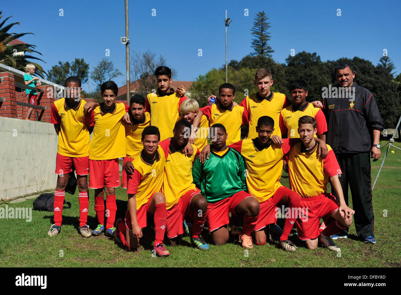 Under 15 Junior football player team with coach, Cape Town, Western Cape, South Africa - Stock Image