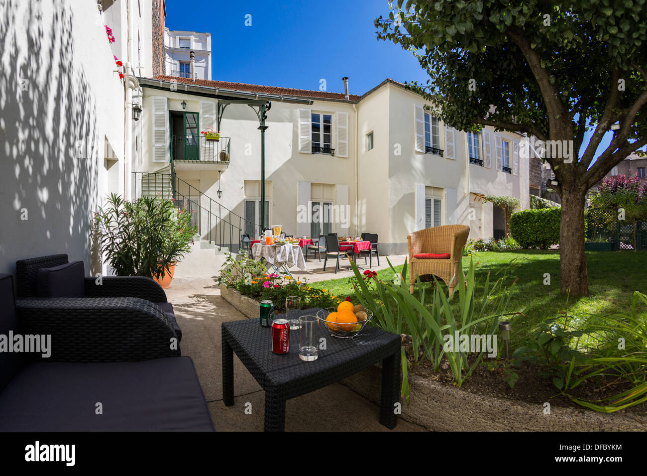 Hotel Courtyard (France). Backyard Back Yard Courtyard Garden Furniture  Lawn   Stock Image
