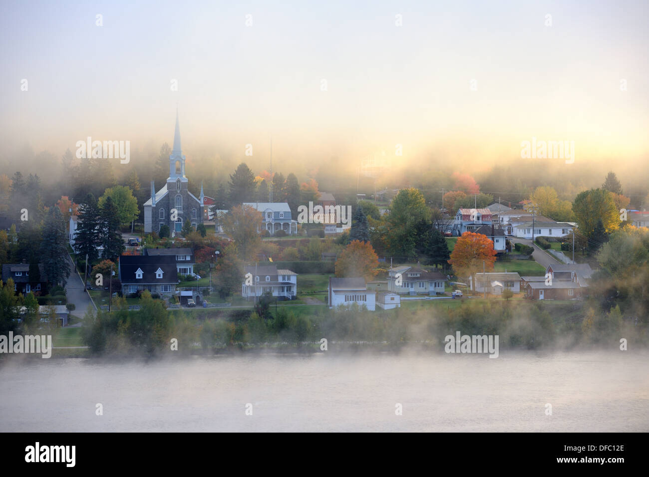 Early morning mist and autumn coloured in Grande Piles Village and St Maurice river  Quebec, Canada - Stock Image