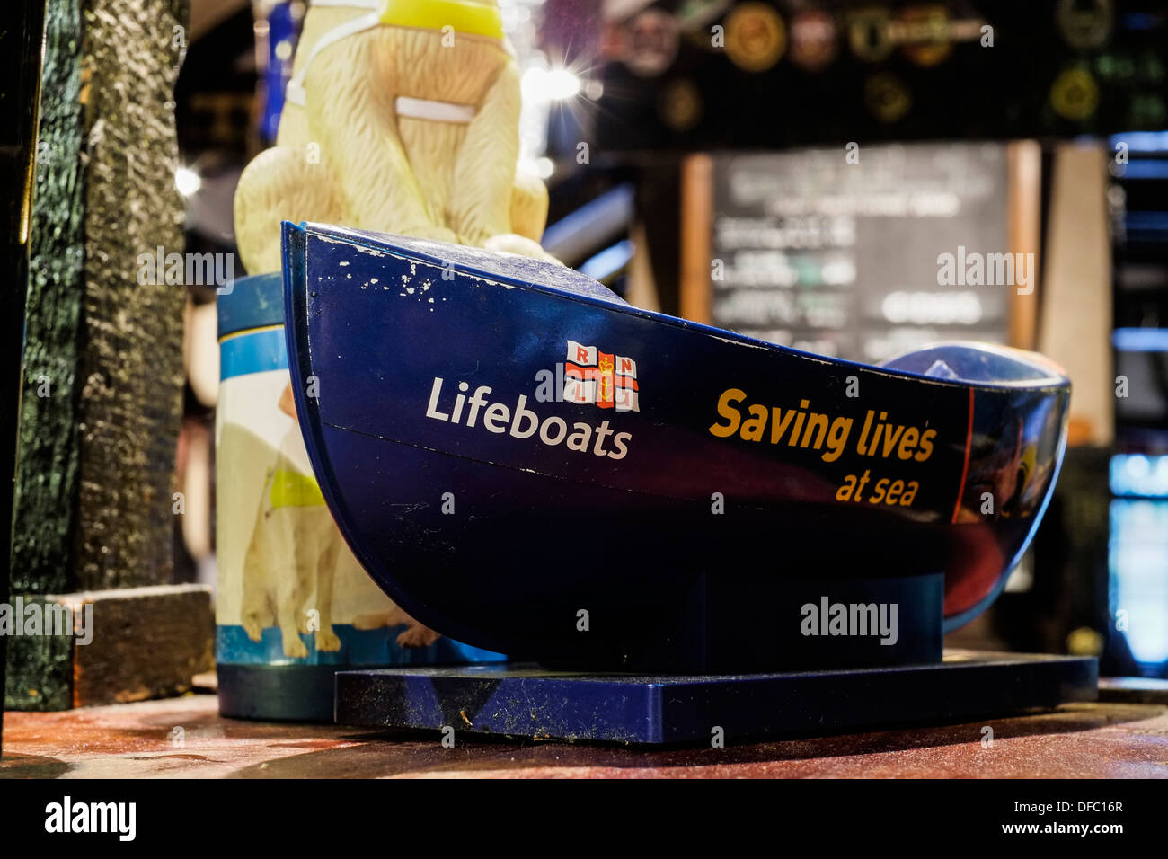 A RNLI Charity collecting box. - Stock Image