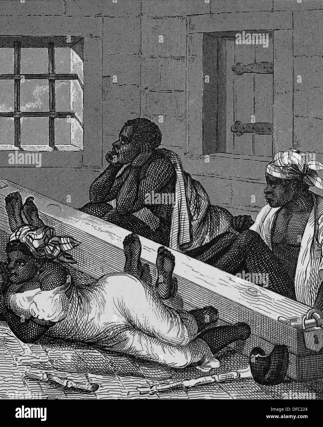 Brazilian slave trade. Black slaves in stocks in Brazil. Engraving. - Stock Image