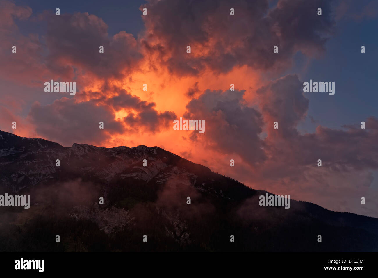 Austria, Tyrol, View of Achenkirch at sunset - Stock Image