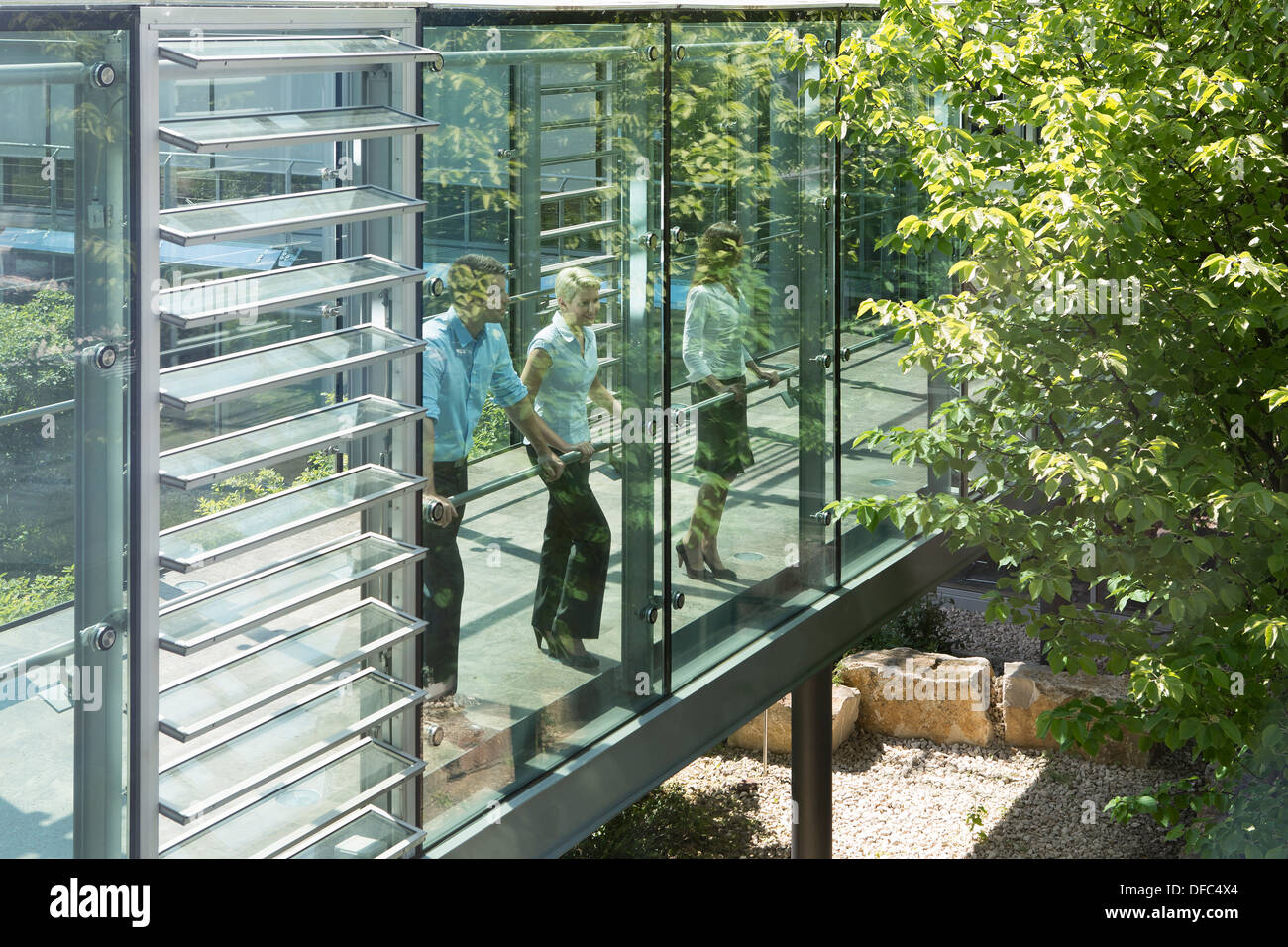 Germany, Hannover, Business people standing in office - Stock Image