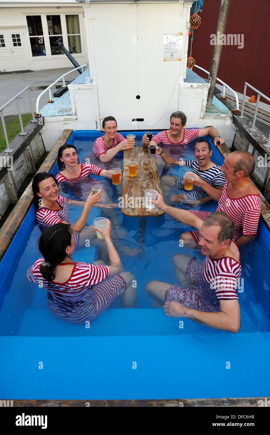 people drinking beer and bathing in an outdoor hot tub settled in a ...