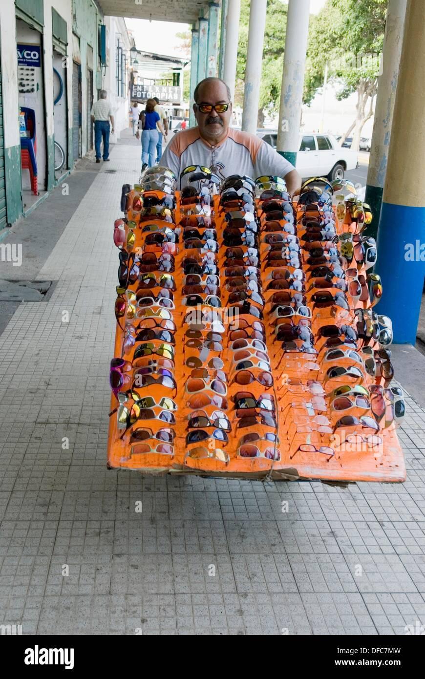 sunglass street seller,Ciudad Bolivar,Bolivarian Republic of Venezuela,South America - Stock Image