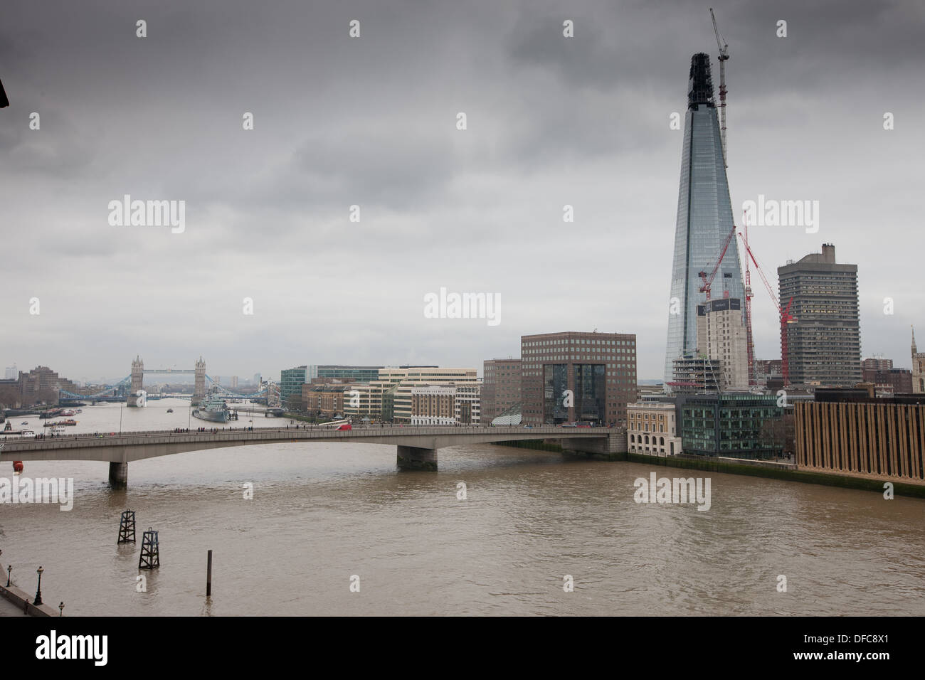 Looking east down the Thames in London at the Shard building on a gloomy day. - Stock Image