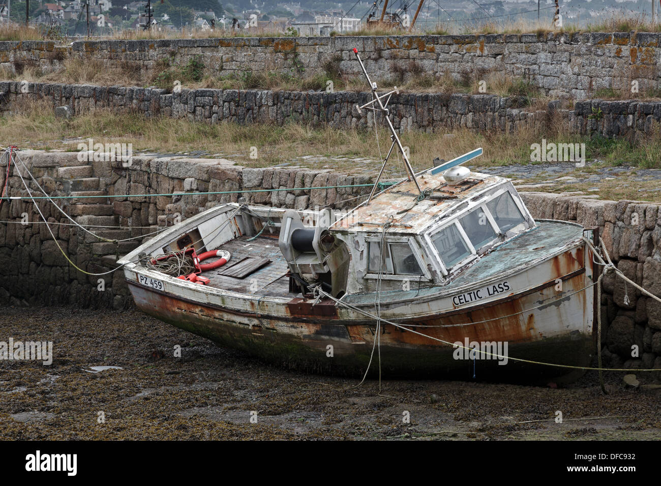 An old fishing boat the 'Celtic Lass', moored up in Newlyn harbour looking like she's seen better days. - Stock Image