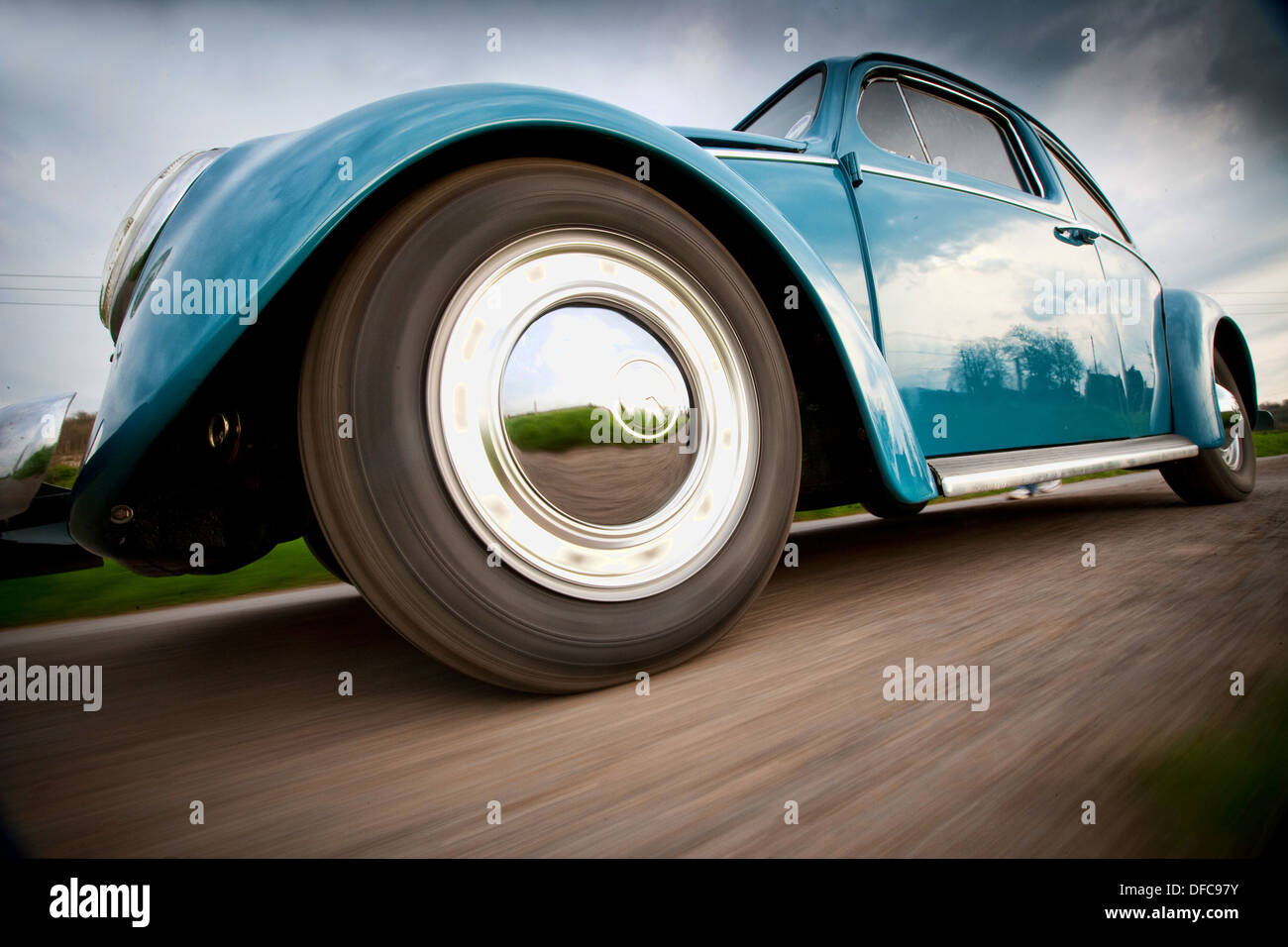 A classic VW Beetle in action - Stock Image