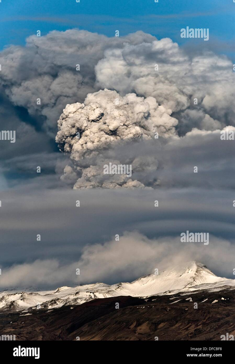 The huge amount of volcanic ash produced created havoc in European air space  Flights were cancelled and passengers stranded - Stock Image