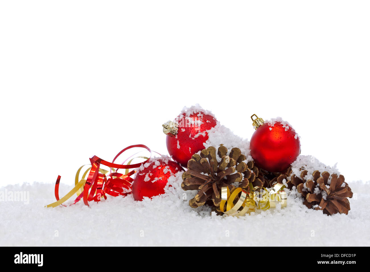 Christmas decorations on snow isolated against a white background. - Stock Image