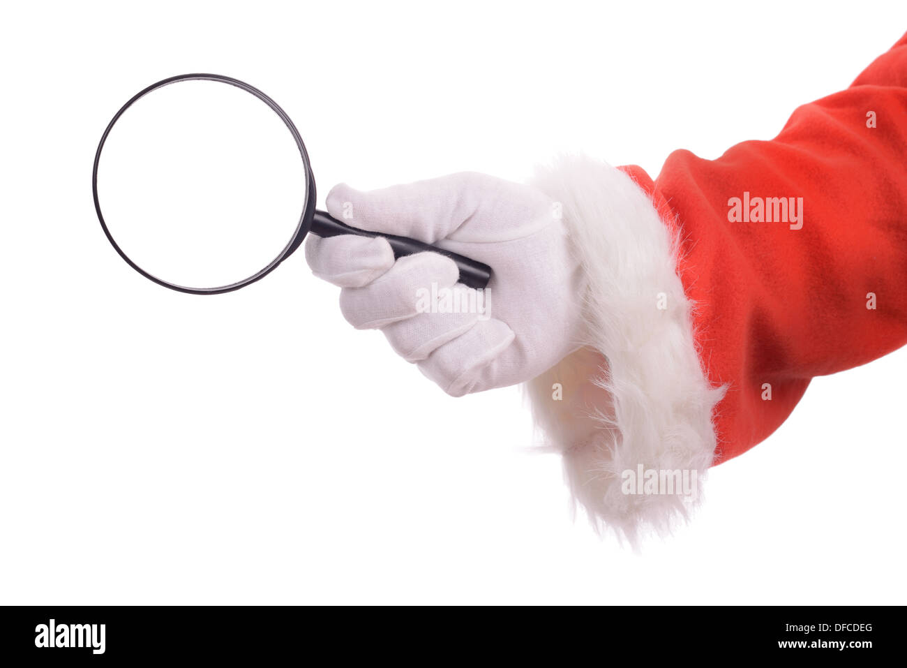 Searching for christmas he perfect gift or bargain, santa's hand holding a magnifying glass isolated on a white background - Stock Image