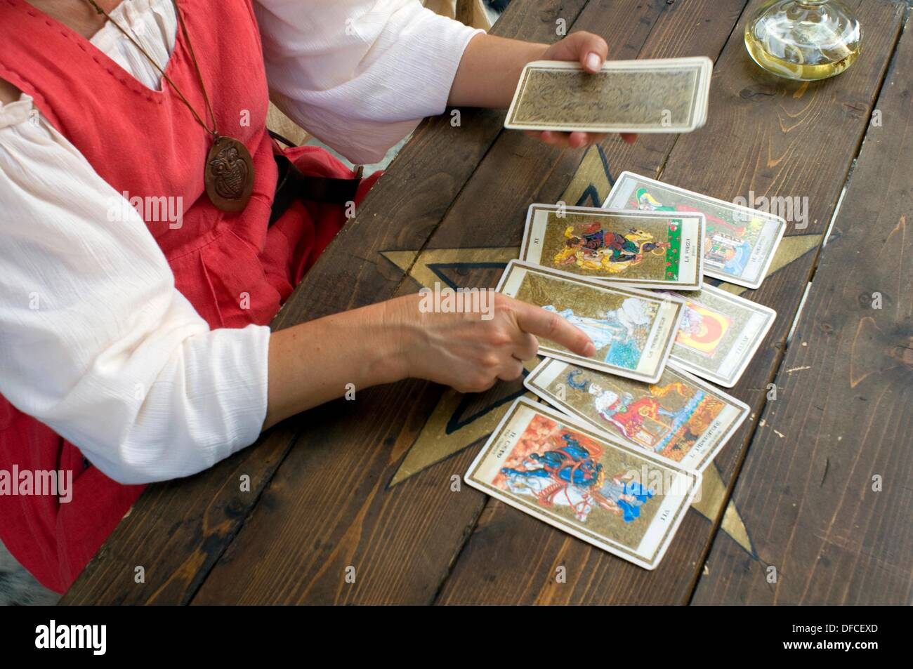 Italy, Lombardy, Fortune teller with cards - Stock Image