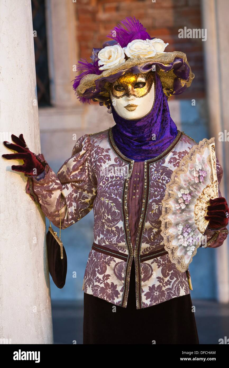 A masked woman at the carnival in Venice, Italy, Europe - Stock Image
